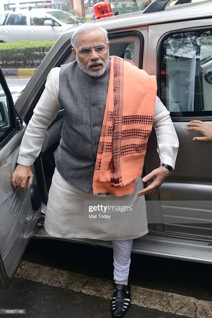 Gujarat Chief Minister Narendra Modi coming out after meeting with Prime Minister Manmohan Singh at 7RCR in New Delhi on Wednesday.
