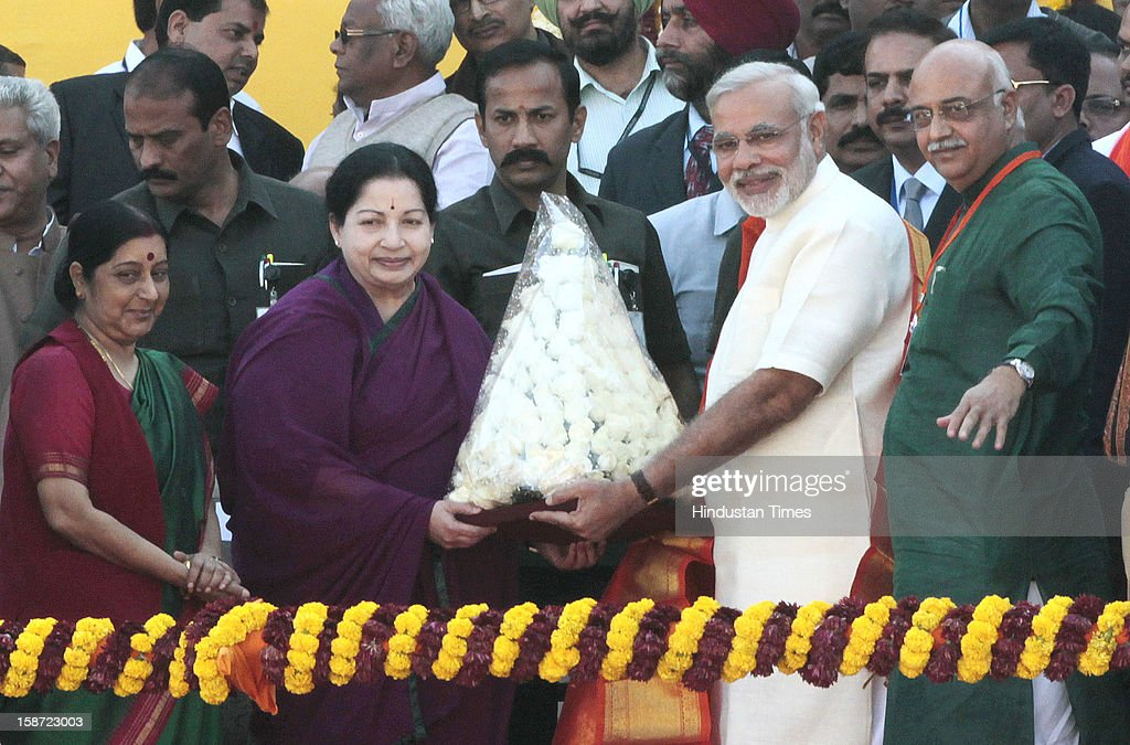 Gujarat chief minister Narendra Modi congratulated by Tamil Nadu Chief Minister Jayalalita during his swearing in ceremony on December 26, 2012 in Ahmedabad, India. Narendra Modi sworn as Chief Minister of Gujarat for fourth successive term.