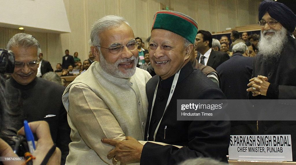 Gujarat Chief Minister Narendra Modi hugs his Himachal Pradesh counterpart Virbhadra Singh during the 57th National Development Council (NDC) meeting on December 27, 2012 in New Delhi, India.