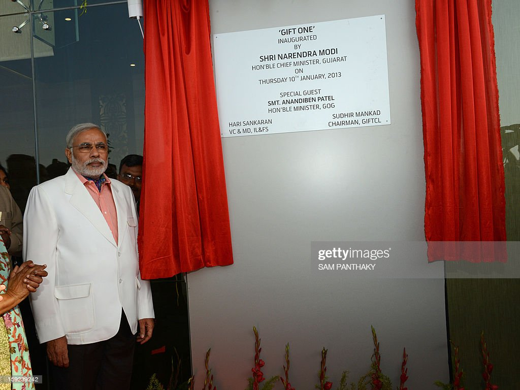 Gujarat Chief Minister Narendra Modi inaugurates the GIFT City Tower 1 in the outskirts of Gandhinagar, some 30 kms. from Ahmedabad, on January 10, 2013. The tower, the state's tallest building at 129 metres high and 29 floors, will house offices of international finance, investment, trade information technology sector companies. AFP PHOTO / Sam PANTHAKY