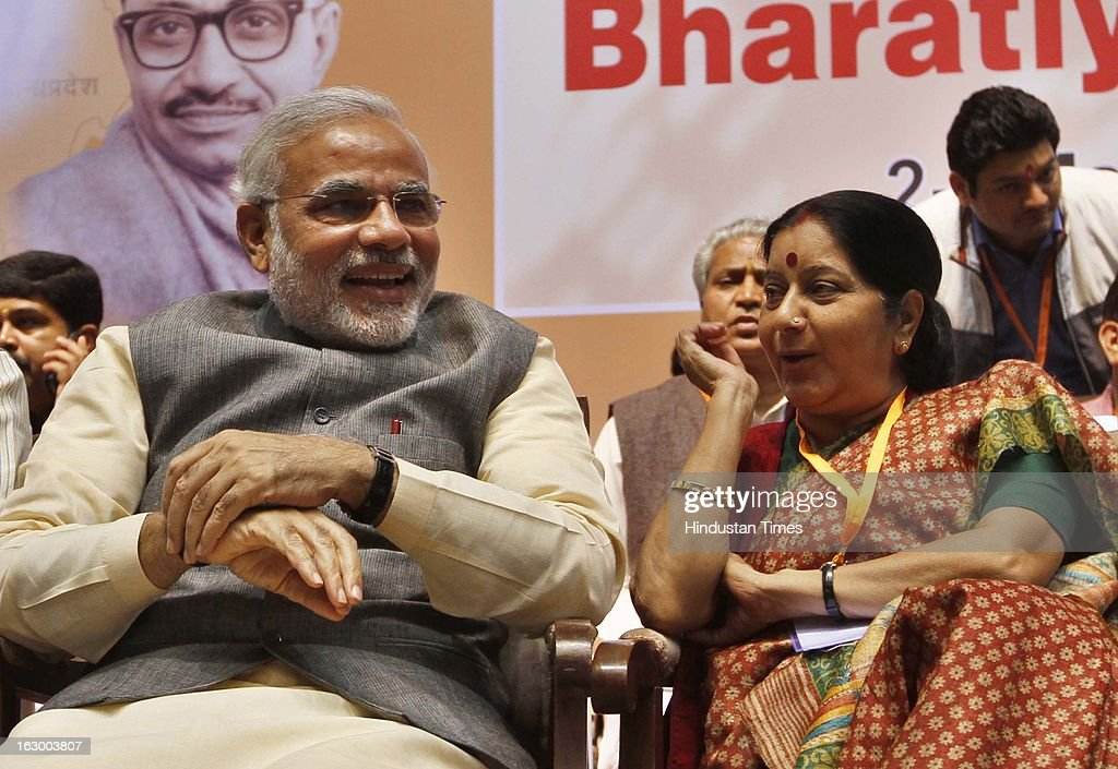 Gujarat Chief Minister Narendra Modi with senior leader Sushma Swaraj during the last day of the Party National Council Meeting on March 3, 2013 in New Delhi, India. Party meeting, which is aimed at strategising for the upcoming assembly and general elections as also looking at a reorganisation of the party structure.