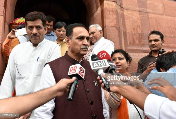 Gujarat Chief Minister Vijay Rupani talking to media persons after swearingin ceremony of President Ram Nath Kovind at Parliament on July 25 2017 in...