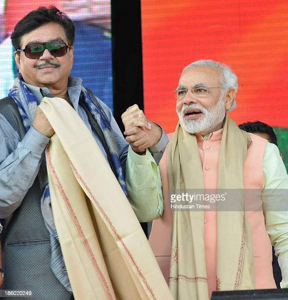 Gujarat CM and BJP's prime ministerial candidate Narendra Modi with Shatrughan Sinha former Bollywood actor and politician at the Hunkar rally on...