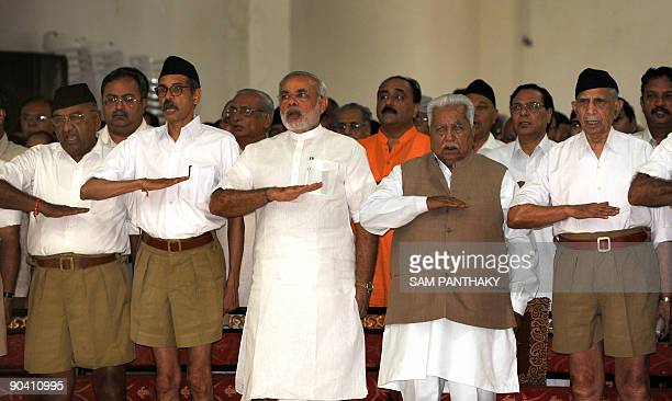 Gujarat state Chief Minister Narendra Modi and former chief minister Keshubhai Patel gesture as they attend a Rashtriya Swayamsevak Sangh gathering...