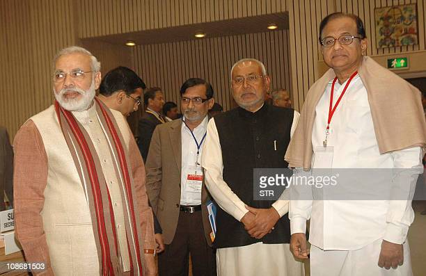 Gujarat state Chief Minister Narendra Modi Bihar chief minister Nitish Kumar and Indian Home Minister P Chidambaram attend the Conference of Chief...