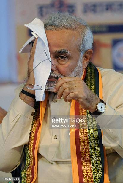 Gujarat state chief minister Narendra Modi wipes his face during the 'Tarun Kranti Puraskar' awards function in Ahmedabad on July 29 2012 Modi...