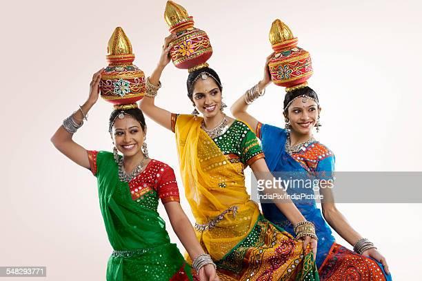 Gujarati women holding a kalash