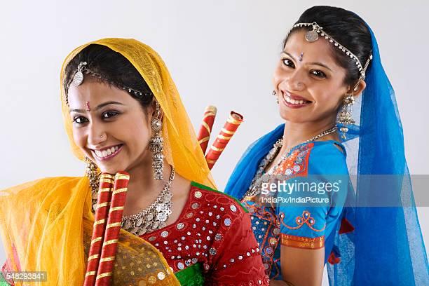 Gujarati women with dandiya sticks