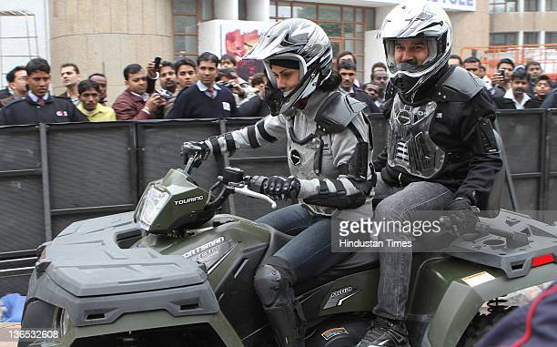 Gul Panag Bollywood actor and a well known autosports enthusiast rides the newly unveiled ATV Sportsman 90 with Pankaj Dubey MD of Polaris during the...