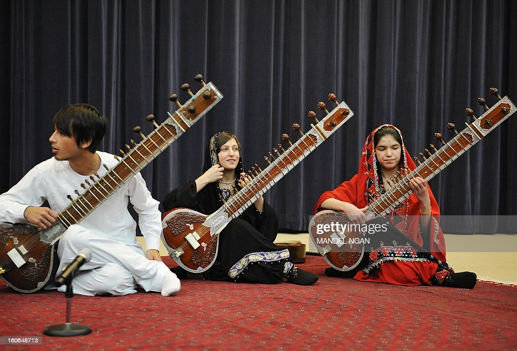 Gulalai Norestani (2nd R) and Huma Rahimy (R), members of the Afghanistan National Institute of Music Sitar and Sarod Ensemble, perform in the Dean Aceson Auditorium on February 4, 2013 in Washington, DC. The performance kicks of a three-city tour of the US. AFP PHOTO/Mandel NGAN