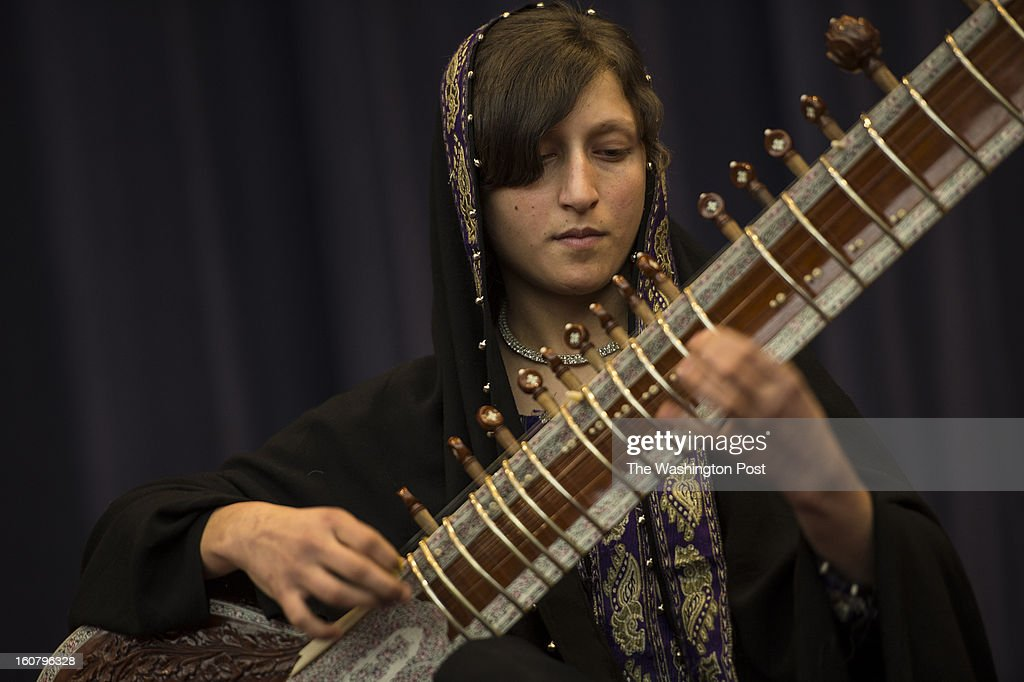 FEBRUARY 4 -- Gulalai Norestani, 14, with the Afghanistan National Institute of Music's Traditional Ensemble, plays the sitar during a performance at the State Department in Washington, D.C., on Monday, February 4, 2013.