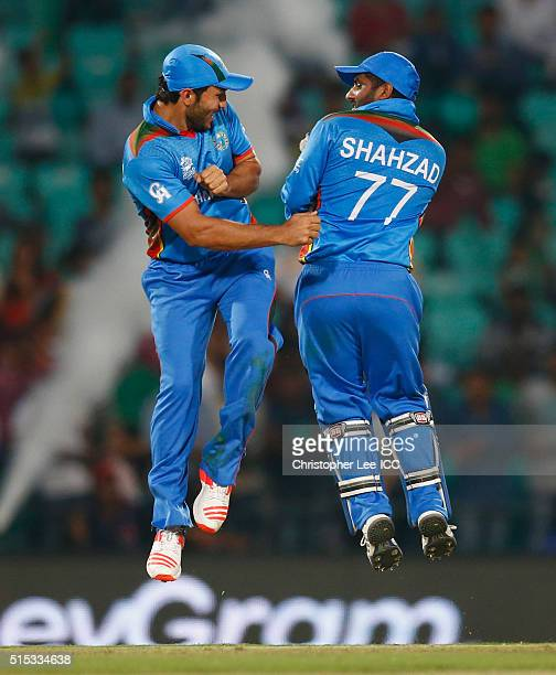 Gulbadin Naib of Afghanistan and Mohammad Shahzad of Afghanistan celebrate their victory during the ICC Twenty20 World Cup Round 1 Group B match...
