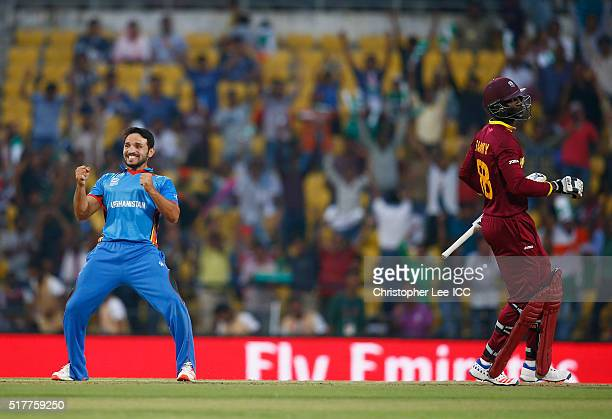 Gulbadin Naib of Afghanistan celebrates taking the wicket of Darren Sammy Captain of the West Indies during the ICC World Twenty20 India 2016 Group 1...