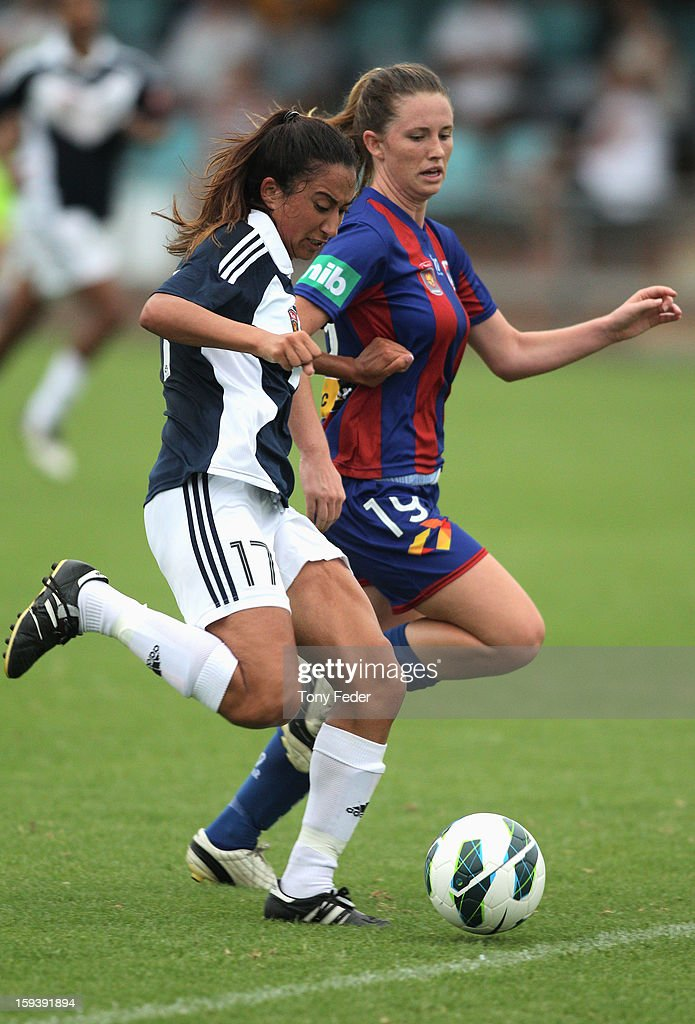 Gulcan Koca of the Melbourne Victory contests the ball with Jasmin Courtenay of the Newcastle Jets during the round 12 W-League match between the Newcastle Jets and the Melbourne Victory at Wanderers Oval on January 13, 2013 in Newcastle, Australia.