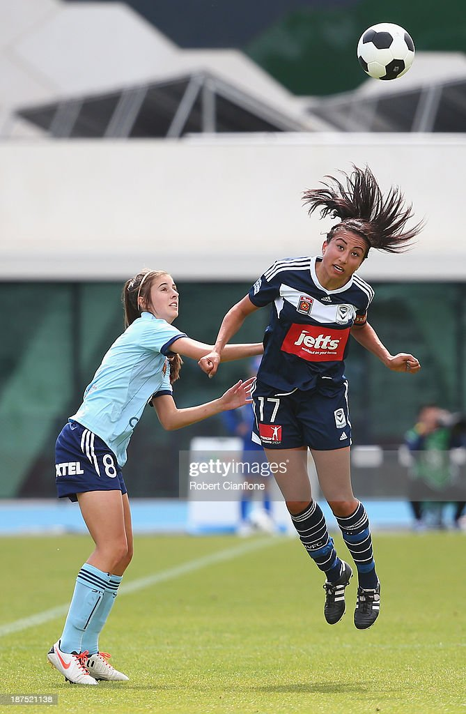 Gulcan Koca of the Victory heads the ball away from Amy Harrison Sydney FC during the round one W-League match between the Melbourne Victory and Sydney FC at Lakeside Stadium on November 10, 2013 in Melbourne, Australia.