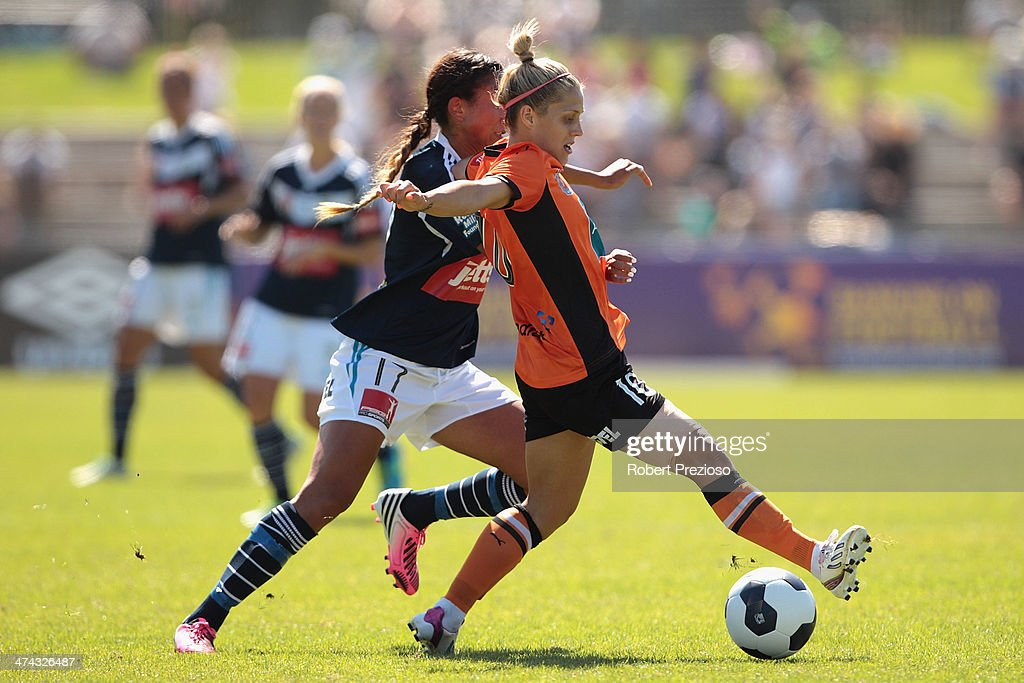 Gulcan Koca of Victory and Katrina-Lee Gorry of Roar contest the ball during the W-League Grand Final match between the Melbourne Victory and the Brisbane Roar at Lakeside Stadium on February 23, 2014 in Melbourne, Australia.
