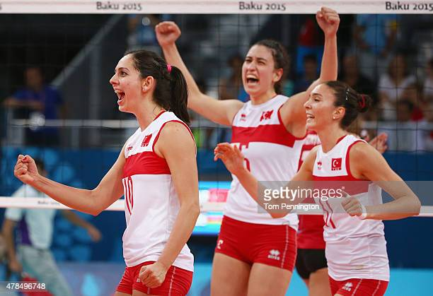 Guldeniz Onal Pasalioglu of Turkey Polen Uslupehlivan of Turkey and Naz Aydemir Akyol of Turkey celebrates during the Women's Volleyball semi final...