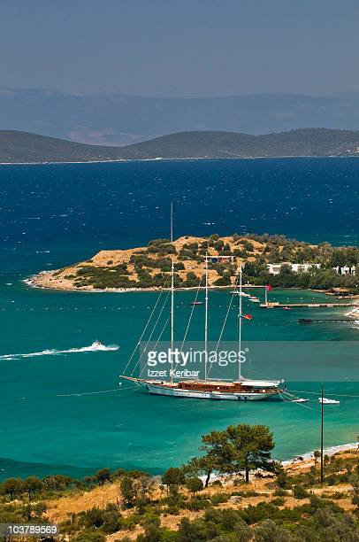 Gulet (traditional Turkish wooden sailing vessel) moored in bay.