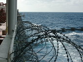Anti-piracy razor wire and cannons. Voyage off the coast of Somalia.