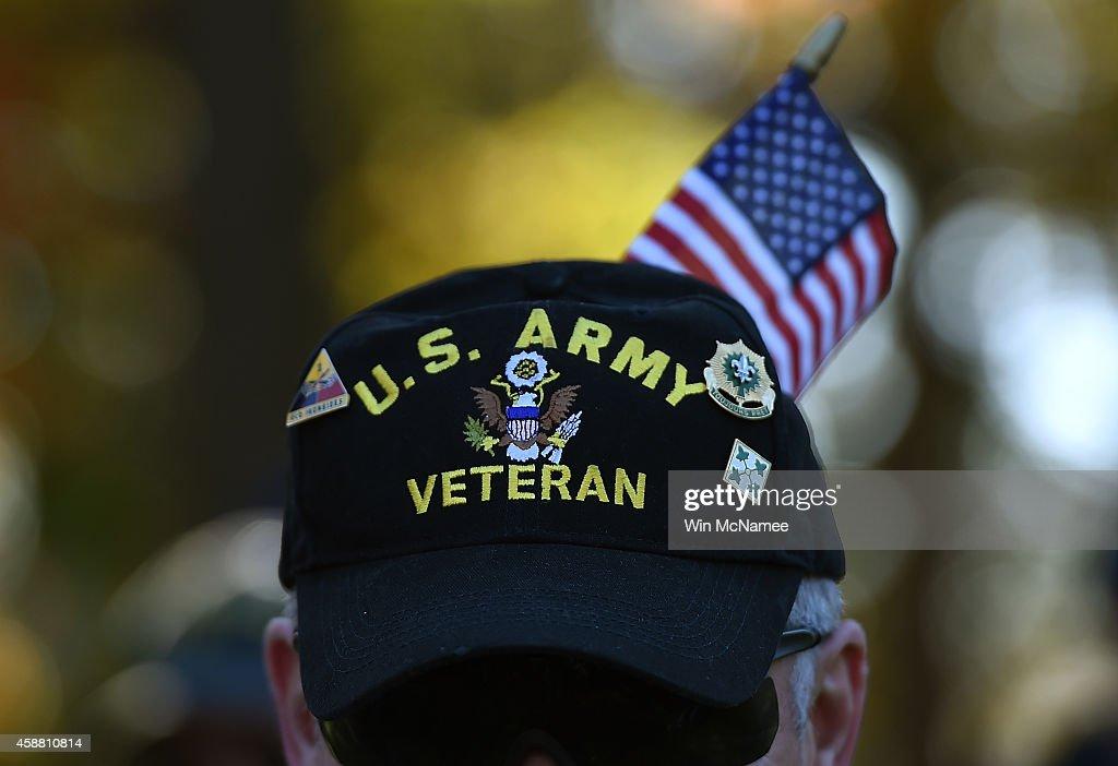 Gulf War veteran Bill Virill retires US Army attends a Veterans Day ceremony at the Vietnam Veterans Memorial November 11 2014 in Washington DC...