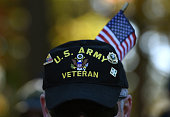 Gulf War veteran Bill Virill retires US Army attends a Veterans Day ceremony at the Vietnam Veterans Memorial November 11 2014 in Washington DC...