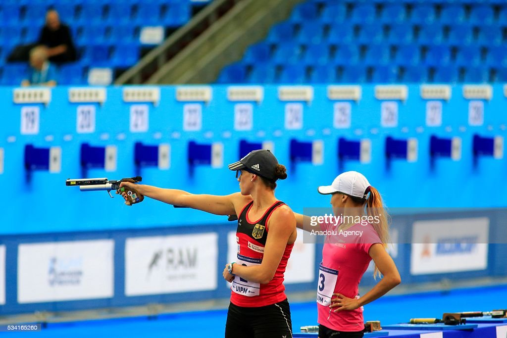 Gulnaz Gubaydullina (R) of Russia and Lena Schoneborn (L) of Germany compete in the Combined of the Women Qualifications at the UIPM senior modern pentathlon world championships in Moscow, Russia, on May 25, 2016.