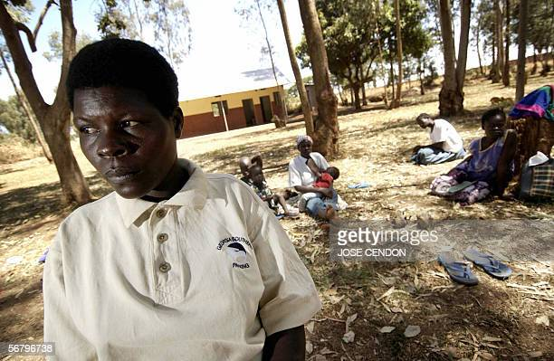Margret former wife of Lord Resistance Army leader Joseph Kony stands beside a bicycle 08 February 2006 at the Santa Monica Tayloring Centre for...