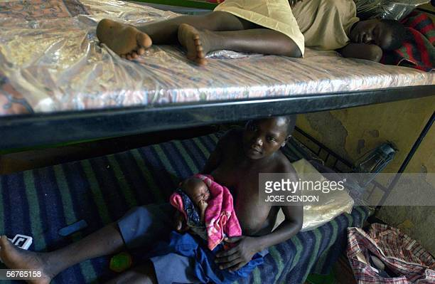 Ugandan women formerly abducted by LRA rebels and used as sexual slaves lay on their beds in a Worldvision centre for war children 05 February 2006...