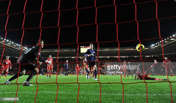 Guly Do Prado of Southampton scores an own goal past Artur Boruc during the Barclays Premier League match between Southampton and Arsenal at St...