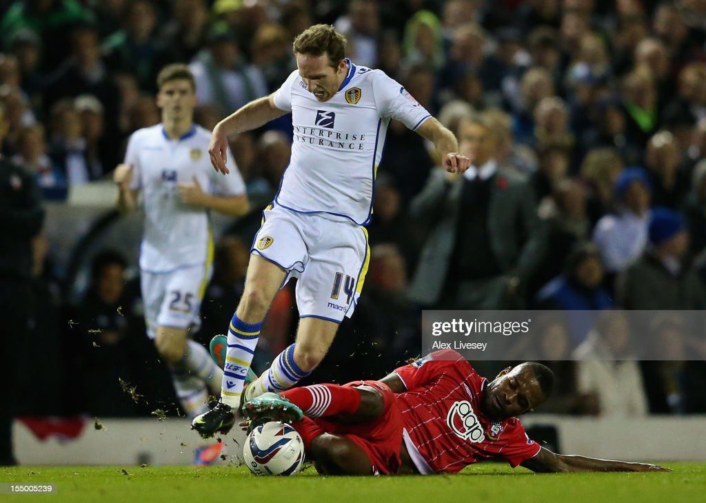 Guly Do Prado of Southampton tackles Aidan White of Leeds United during the Capital One Cup Fourth Round match between Leeds United and Southampton at Elland Road on October 30, 2012 in Leeds, England.