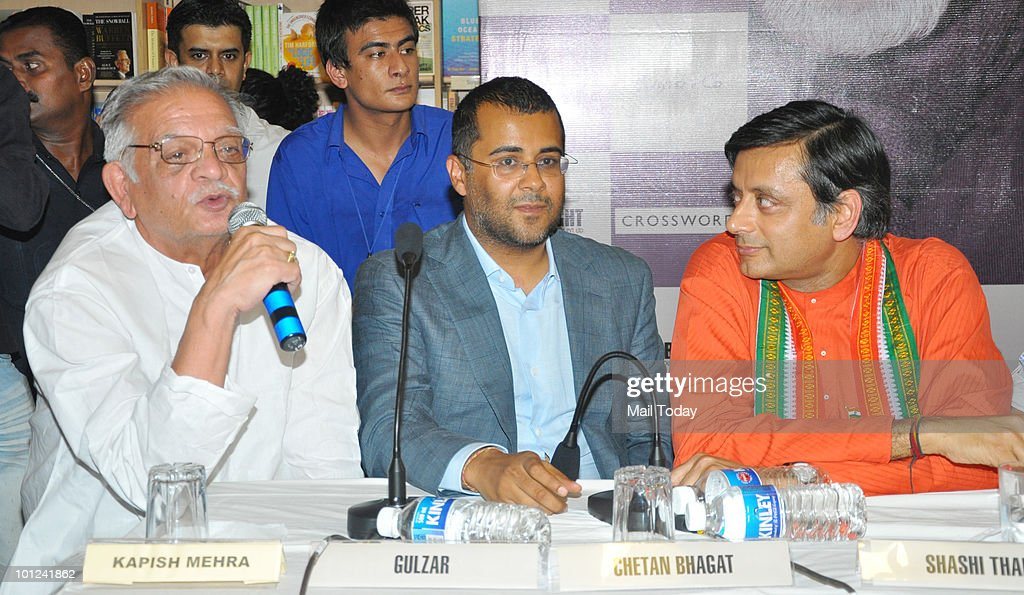 Gulzar, Chetan Bhagat and Shashi Tharoor at the launch of Nandy's book of poems 'Again' in Mumbai on May 27, 2010.