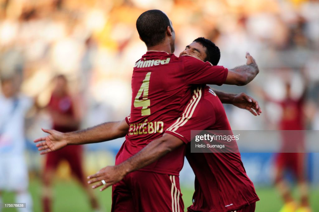 Gum (R) and Euzebio (L) of Fluminense celebrate a goal against Ponte Preta during a match between Fluminense and Ponte Preta as part of the Brazilian Championship Serie A 2013 at Moises Lucarelli Stadium on August 04, 2013 in Campinas, Brazil.