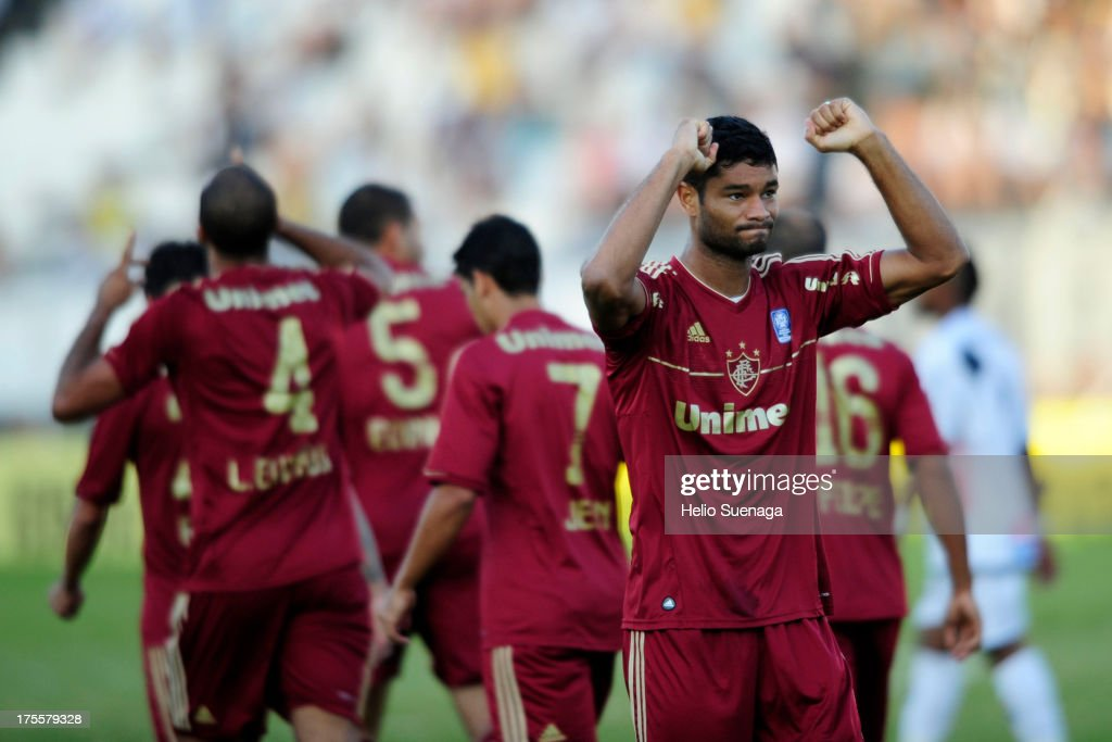 Gum and his teammates of Fluminense celebrate a a scored goal against Ponte Preta during a match between Fluminense and Ponte Preta as part of the Brazilian Championship Serie A 2013 at Moises Lucarelli Stadium on August 04, 2013 in Campinas, Brazil.