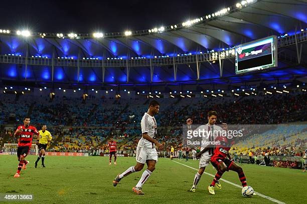 Gum and Rafael Sobis of Fluminense struggles for the ball with Negueba of Flamengo during a match between Fluminense and Flamengo as part of...