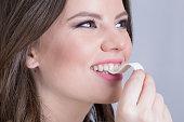 Brunette biting a bubble gum