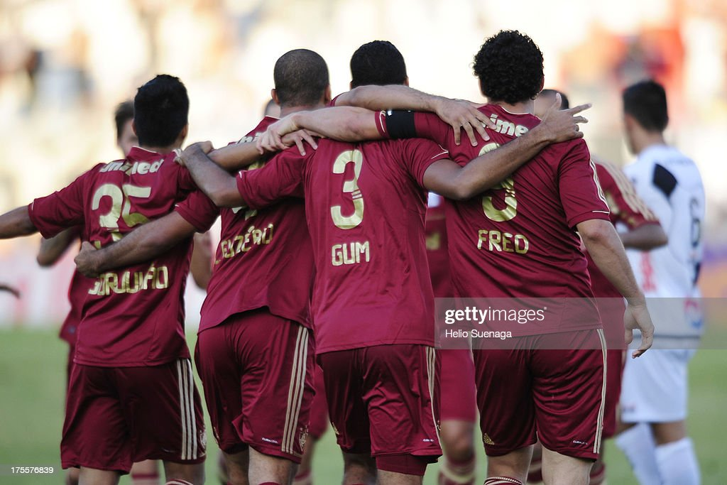 Gum (R) of Fluminense and his teammates celebrate a goal against Ponte Preta during a match between Fluminense and Ponte Preta as part of the Brazilian Championship Serie A 2013 at Moises Lucarelli Stadium on August 04, 2013 in Campinas, Brazil.