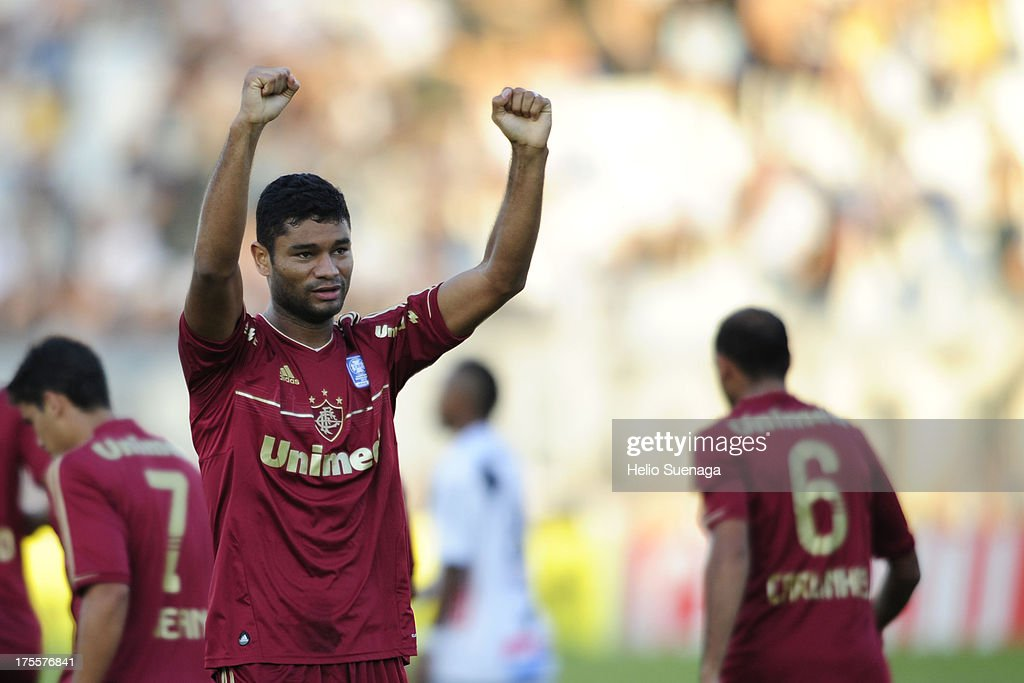 Gum of Fluminense celebrates a goal against Ponte Preta during a match between Fluminense and Ponte Preta as part of the Brazilian Championship Serie A 2013 at Moises Lucarelli Stadium on August 04, 2013 in Campinas, Brazil.