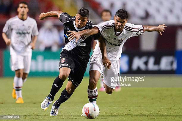 Gum of Fluminense fights for the ball with a Romario during the match between Fluminense and Vasco as part of Carioca Championship 2013 at Engenhao...