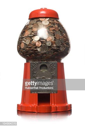 gumball machine full of money : Foto de stock