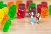 Gummy bear invasion. Junk food concept