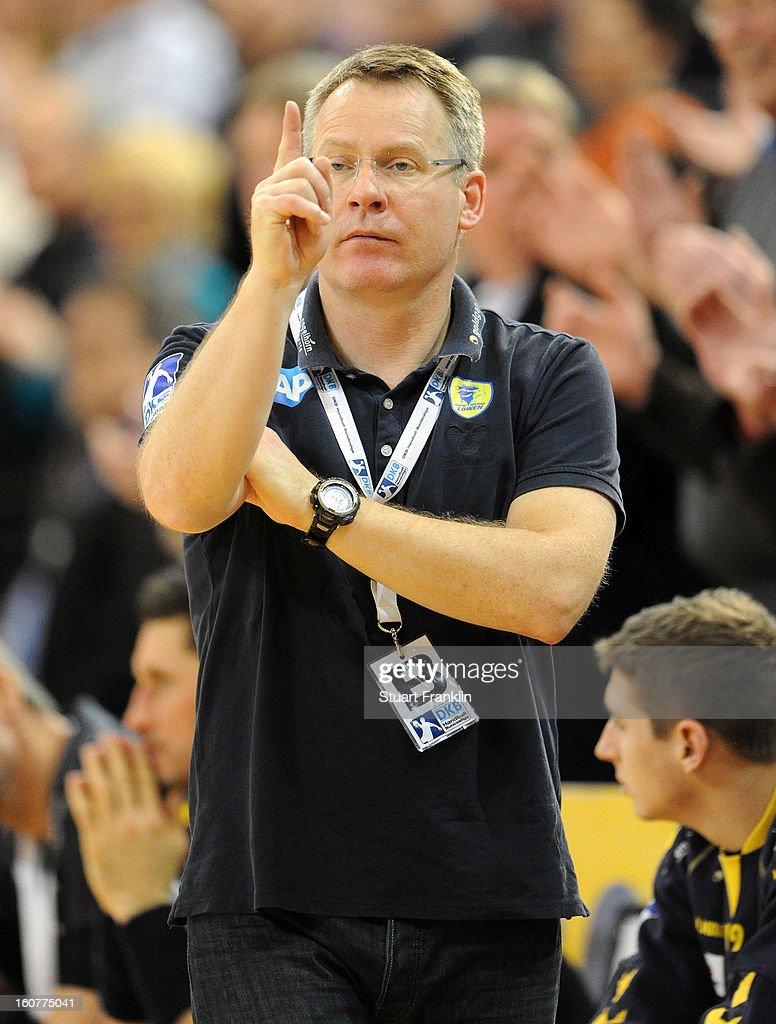 Guðmundur Guðmundsson, head coach of Rhein-Neckar reacts during the DHB cup game between SG Flensburg Handewitt and Rhein-Neckar Loewen at the Flens Arena on February 5, 2013 in Flensburg, Germany.