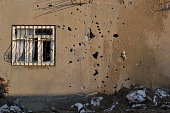 Window with bullet hole on war.