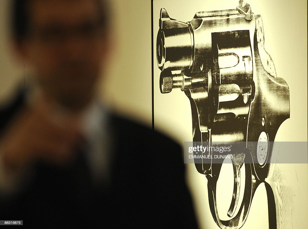 'Gun' by artist Andy Warhol is on display at Christie's during a press preview of their Post War and Contemporary Art Evening Sales in New York on May 01, 2009. The painting will go under the hammer with an estimate of 2.2-2.8 million USD on May 13. AFP PHOTO/Emmanuel Dunand