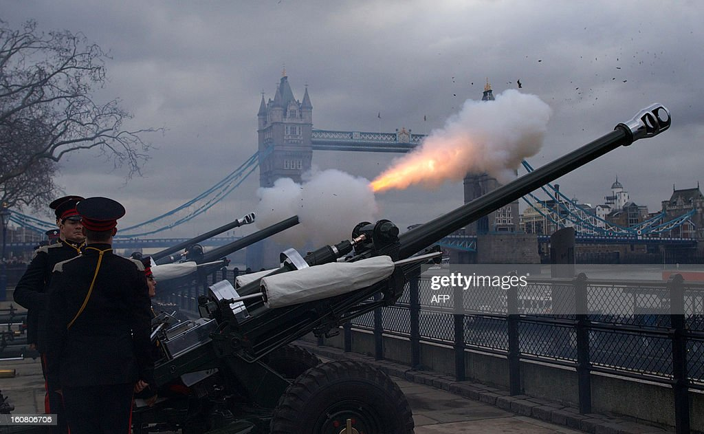 A gun fires in of Tower Bridge as members of Honourable Artillery Company (HAC), the City of London's Territorial Army Regiment, fire a 62 gun salute in honour of the 61st anniversary of Britain's Queen Elizabeth II's accession to the throne at the Tower of London on February 6, 2013.