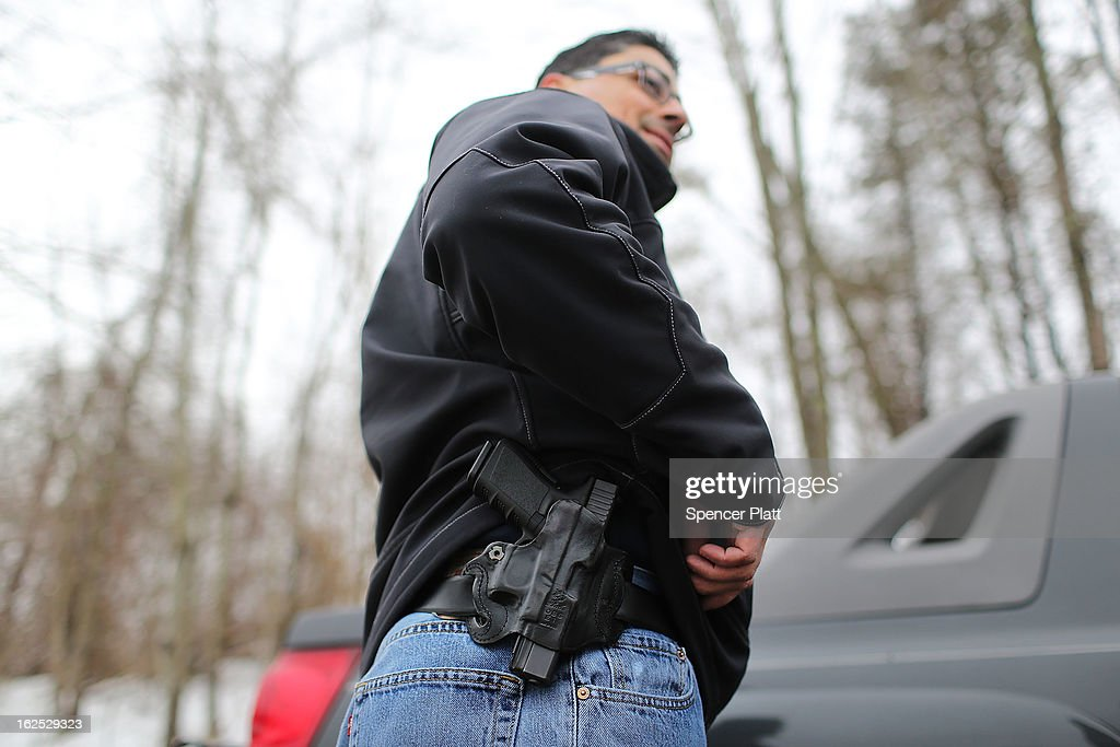 A gun owner displays his pistol at a class taught by King 33 Training at a shooting range on February 24, 2013 in Wallingford, Connecticut. King 33 Training, a company that trains and educates individuals on the safe and proper use of guns and other uses of protective force, offers classes to marksmen of all levels. The Connecticut company offers training for clients interested in maintaining a safe environment for themselves, their families, and those around them. Connecticut, home to a number of gun manufactures including Colt Defense, is a state with conflicting views on guns and gun ownership. Currently the state has some of the strictest gun control laws in the nation and its current governor Daniel Malloy is pushing for tougher measures following the shootings at the Sandy Hook School.