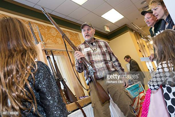A gun rights advocate shows off a civil war rifle during a break at the South Carolina Tea Party Coalition convention on January 18 2015 in Myrtle...