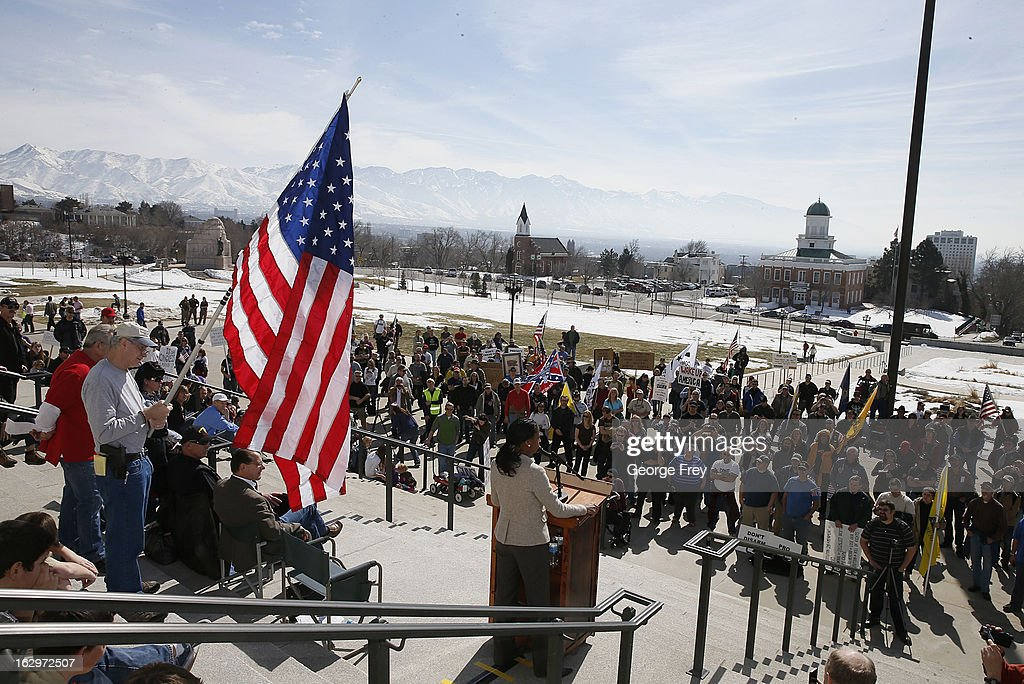 Gun rights supporters hold signs, flags and listen to former Republican congressional candidate from Utah, Mia Love, speak at a gun rights rally and march at the Utah State Capitol on March 2, 2013 in Salt Lake City, Utah. The rally attracted several hundred people for the march to the Utah Capitol in favor of 2nd Amendment rights as gun control supporters call for more limits and bans on assault weapons.