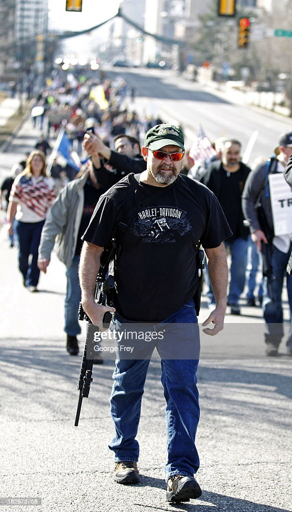 Gun rights supporters walk up State Street to a gun rights rally at the Utah State Capitol on March 2, 2013 in Salt Lake City, Utah. The rally attracted several hundred people for the march to the Utah Capitol in favor of 2nd Amendment rights as gun control supporters call for more limits and bans on assault weapons.