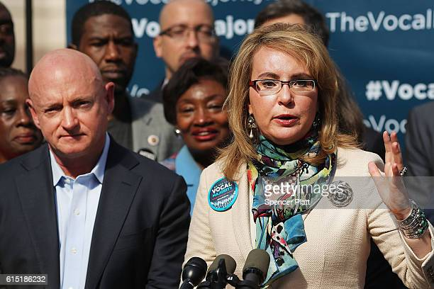 Gun violence victim and former US Congresswoman Gabby Giffords speaks next to her husband NASA astronaut Mark Kelly as they visits City Hall on her...