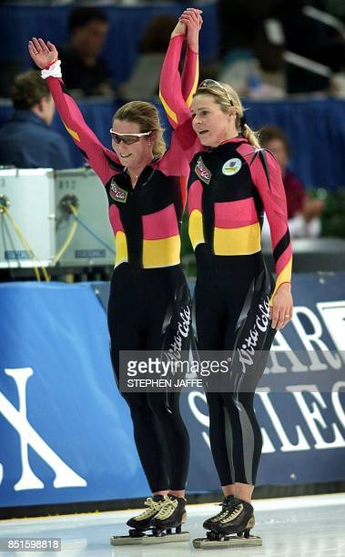 Gunda NiemannStirnemann is congratulated by Claudia Pechstein both of Germany after NiemannStirnemann skated to a world record and gold medal in the...